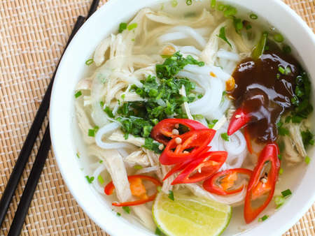 Asian chicken rice noodle soup photo