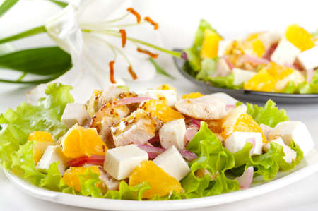 Two servings of salad with chicken, feta cheese, orange, red onion and mustard dressing Stock Photo