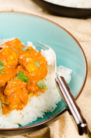 british cuisine: Indian dish - Chicken tikka masala served with rice and garnished with cilantro leaves
