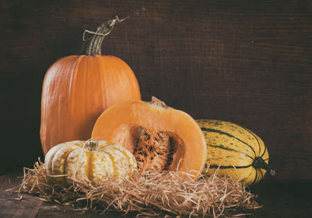 Pumpkins on wooden background toned Stock Photo
