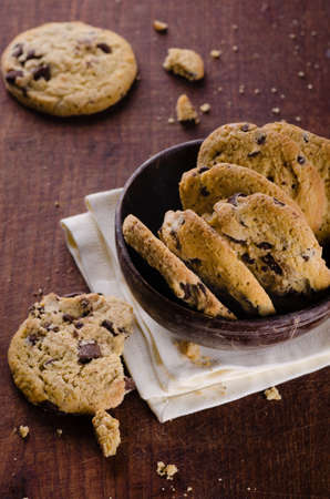 Chocolate chip cookies in a bowl on wooden table Stok Fotoğraf