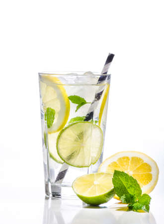 Glass of lemonade with lemon, lime on white background
