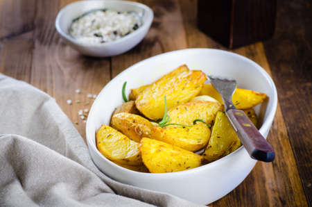 Roasted potato rustic style on wooden background Stock Photo