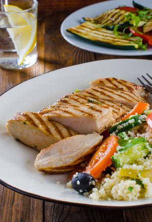 Grilled chicken breast with tabbouleh salad and grilled vegetables Stock Photo