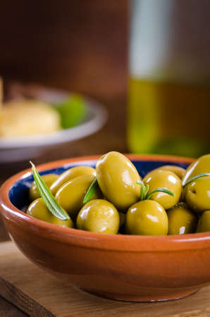 Green olives on a wooden background Stock Photo