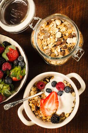 Healthy breakfast with muesli, berries and yoghurt Stock Photo