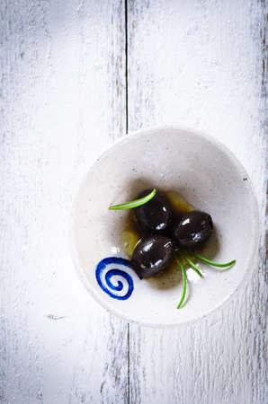 Black kalamata olives in small bowl
