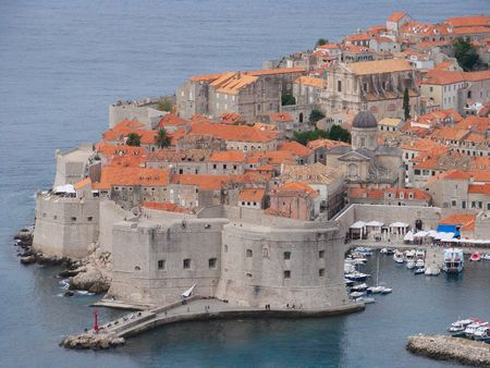 One of the best ways to start a visit to Dubrovnik is by taking a walk around the City Walls, to get a feeling for the layout and the history of the city. All the views are breathtaking. Here Fort Sv. Ivan can be seen which gards the Old Harbour.