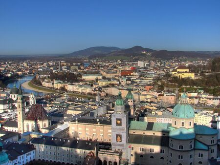 The inner city of Salzburg is separated by the Salzach river. The old sovereignity (Old Town) is located on the left riverbank. Salzburg is also known as Austrian Paris beacuse of the number of churches. Salzburg Cathedral is in the middle of the picture. Standard-Bild