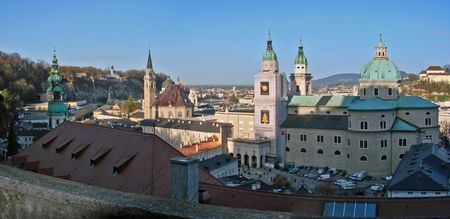 Panorama of Old Town of Salzburg located on the left riverbank which is known by name Austrian Paris beacuse of the number of churches. Here can be seen (right to left) Salzburg Cathedral, Franciscan Church, St. Peter's cemetery.