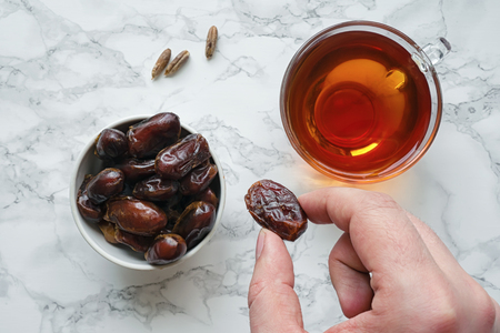 date fruit: Date fruit in human hand. Stock Photo