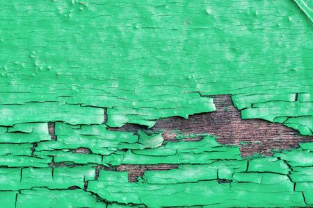 craked: Craked green paint on wooden wall