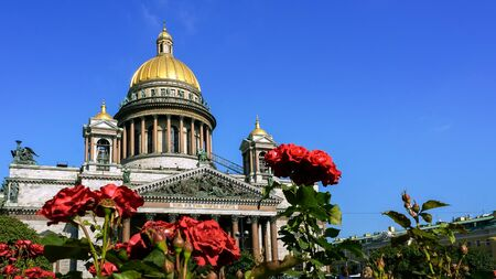 isaac: Saint Isaac Cathedral with roses in Saint-Petersburg, Russia. Stock Photo