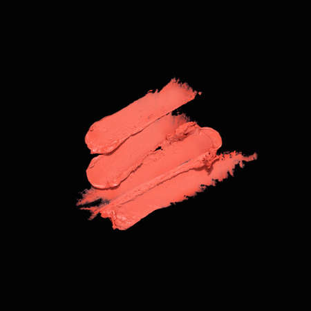 Creative concept photo of cosmetics swatches on black background.