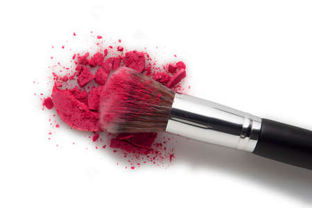 Creative concept beauty fashion photo of cosmetic product make up brushes kit with smashed lipstick eyeshadow on white background. Stock Photo