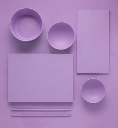 Creative concept health diet asian japanese food photo of painted plates dishes tableware with chopsticks on purple background.