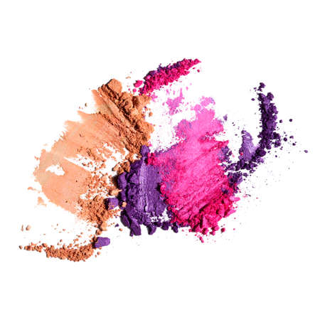 Creative beauty fashion concept photo of cosmetic products lipstick eyeshadows swatches on white background.