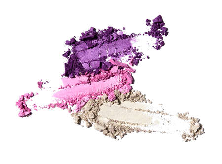 Creative beauty fashion concept photo of cosmetic products lipstick eyeshadows swatches on white background. Imagens