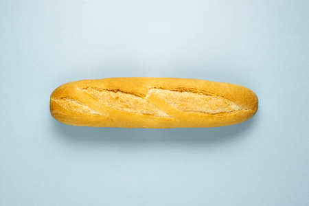 Creative food health diet concept photo of baked cooked pastry bread sliced on blue background.