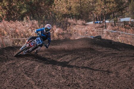 Motocross rider in action. Motocross sport. Close-up photo. Active extreme rest.