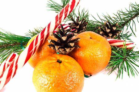 Orange mandarins or tangerines with christmas baubles isolated on white background. Closeup photos of fresh citrus fruit.