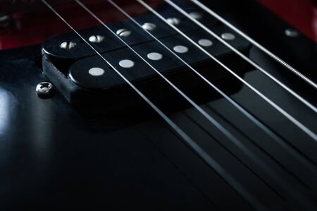 Red electric guitar with neck strings, fingerboards closeup isolated on black background 版權商用圖片