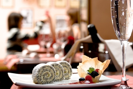 wine and dine: Sweets with a couple on rear Stock Photo
