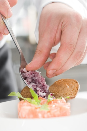 Chef prepearing salmone insalata