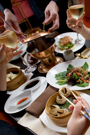 east asian ethnicity: Celebration in chineese restaurant Stock Photo