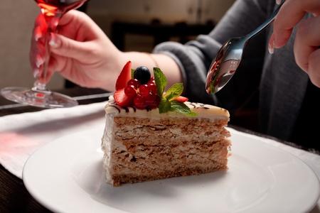 Eating fresh Esterhazy cake with berries