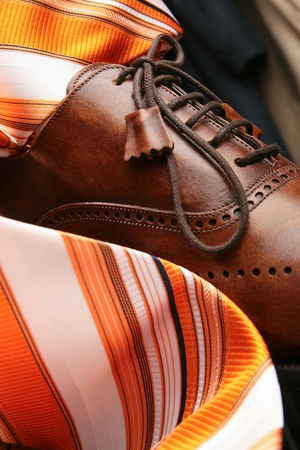 classic contrast: Composition from leather boots and tie Stock Photo