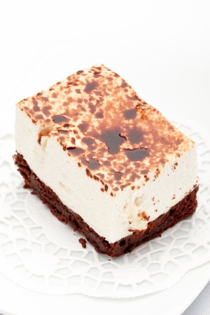 coffeetime: A piece of cheese and chocolate cake on a white plate, isolated
