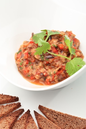 Close up of the caviar made of eggplants and tomatoes. Ukrainian cuisine.