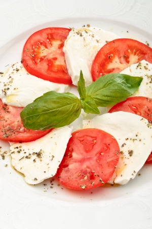 Close up of Caprese salad - tomatoes, mozzarella and basil