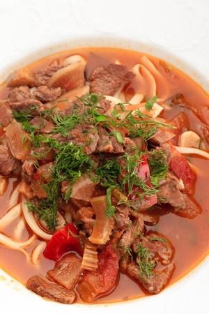 uzbek: Close up of oriental uzbek soup lagman decorated with greens Stock Photo