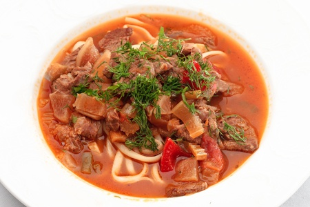 Close up of oriental uzbek soup lagman decorated with greens Stock Photo
