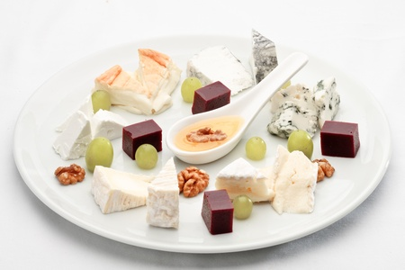 elite: Elite French cheese assorted, decorated with fruit on a platter Stock Photo