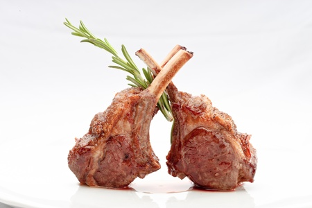 lion and lamb: Lamb lion with thyme elegantly served on a white background isolated Stock Photo