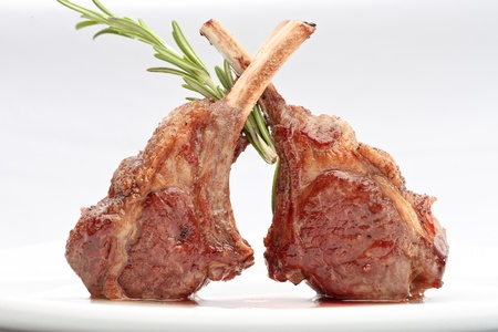 Lamb lion with thyme elegantly served on a white background isolated Reklamní fotografie