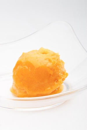 Mango sorbet in a glass bowl on a white background isolated Stock Photo - 10258292