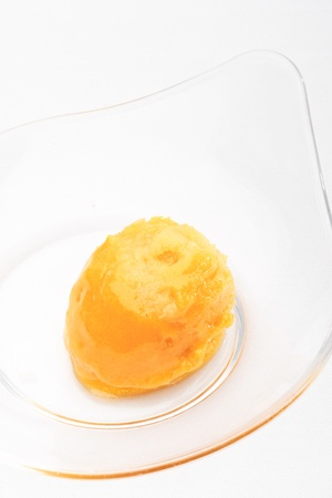 Mango sorbet in a glass bowl on a white background isolated Stock Photo - 10258291