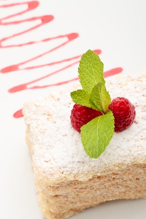 mille-feuille with raspberry on top decorated on a white background Stock Photo