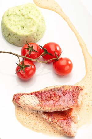 Red mullet with mashed potatoes and vegetables photo