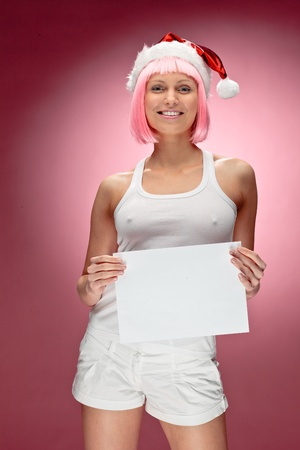 Female santa holding a christmas white box over red background photo