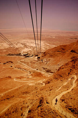 judean desert: Cable to Masada, Judean Desert, Israel. The Dead Sea is in the background.