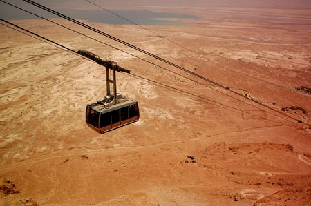 Cable to Masada, Judean Desert, Israel. The Dead Sea is in the background.