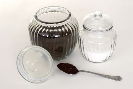 A jar of coffee and sugar on a white background. Stock fotó