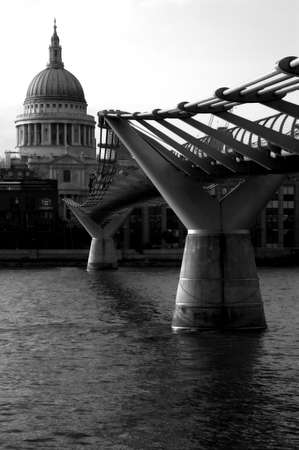 st pauls: St Pauls Cathedral and Millennium Bridge over the River Thames. Stock Photo