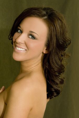 twentysomething: A beautiful model on a green isolated background. Stock Photo