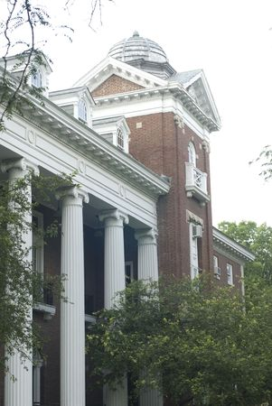 sorority: Large brick Colonial edifice could be on campus, in an office park, or housing government operations.